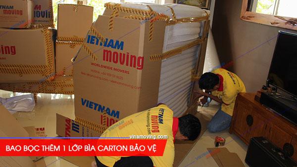 Dịch vụ vận chuyển đàn piano Vina Moving uy tín chuyên nghiệp, Bao bọc thêm 1 lớp bìa Carton nữa để đảm bảo an toàn cho đàn Piano